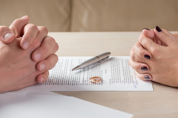 Couple signing a divorce agreement together
