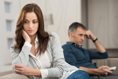 unhappy couple sitting on couch